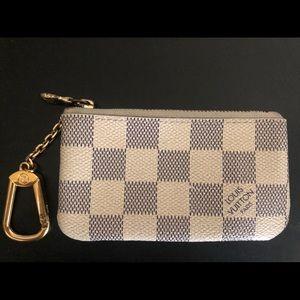 Damier Azur Louis Vuitton key pouch.